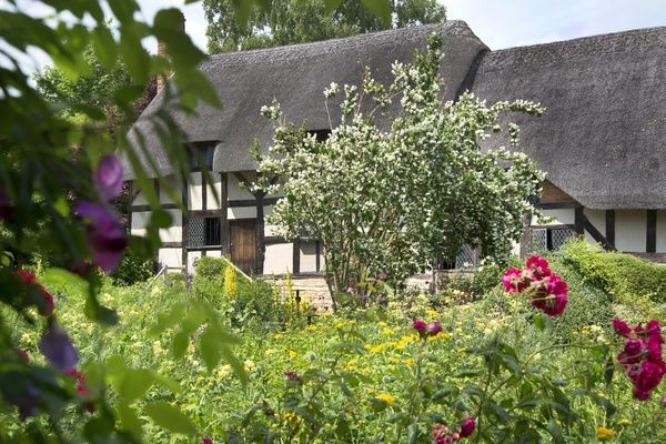 Anne Hathaway's Cottage & Gardens. The thatched cottage was the family home of Shakespeare's wife. The cottage is located in Shottery village a mile west from Stratford Upon Avon town centre